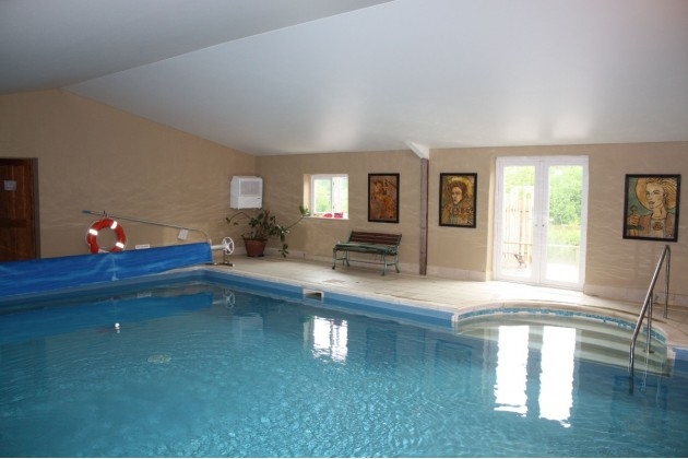 the heated swiming pool - shared with holiday cottages