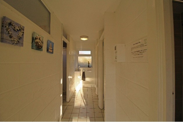View into the uni-sex shower and toilet block.