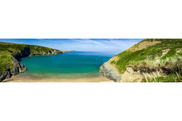 One of our nearest beaches, Mwnt, a National Trust beach. Dolphins are often spotted from here!