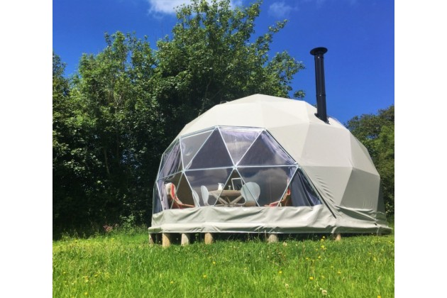 Glamping Nature Domes at Top of the Woods. Cosy up around the log burners & enjoy the stunning views of the Pembrokeshire National Park.
