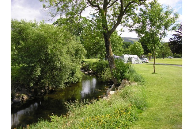 camping pitches by the river